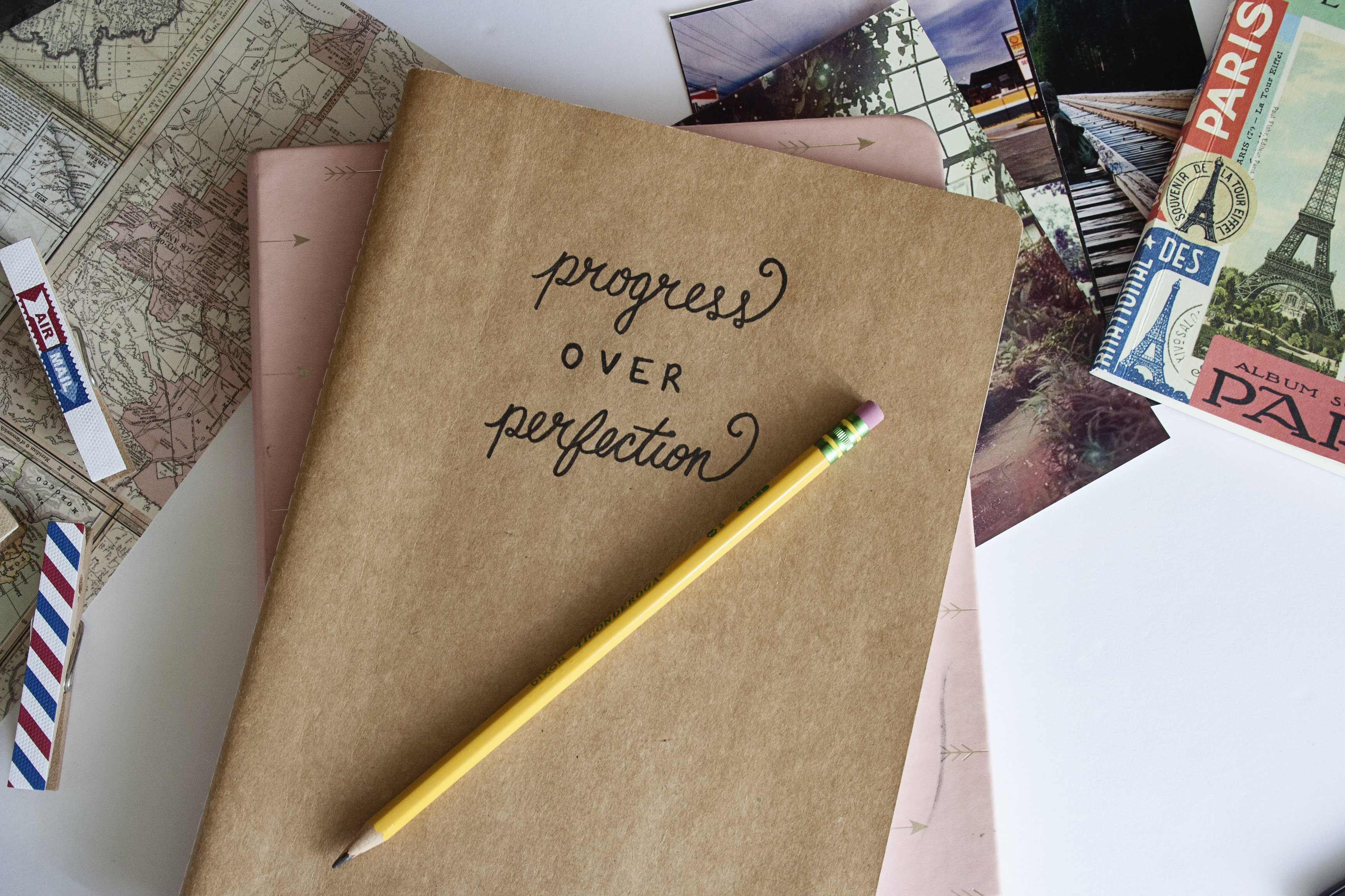 Progress over perfection on a notebook