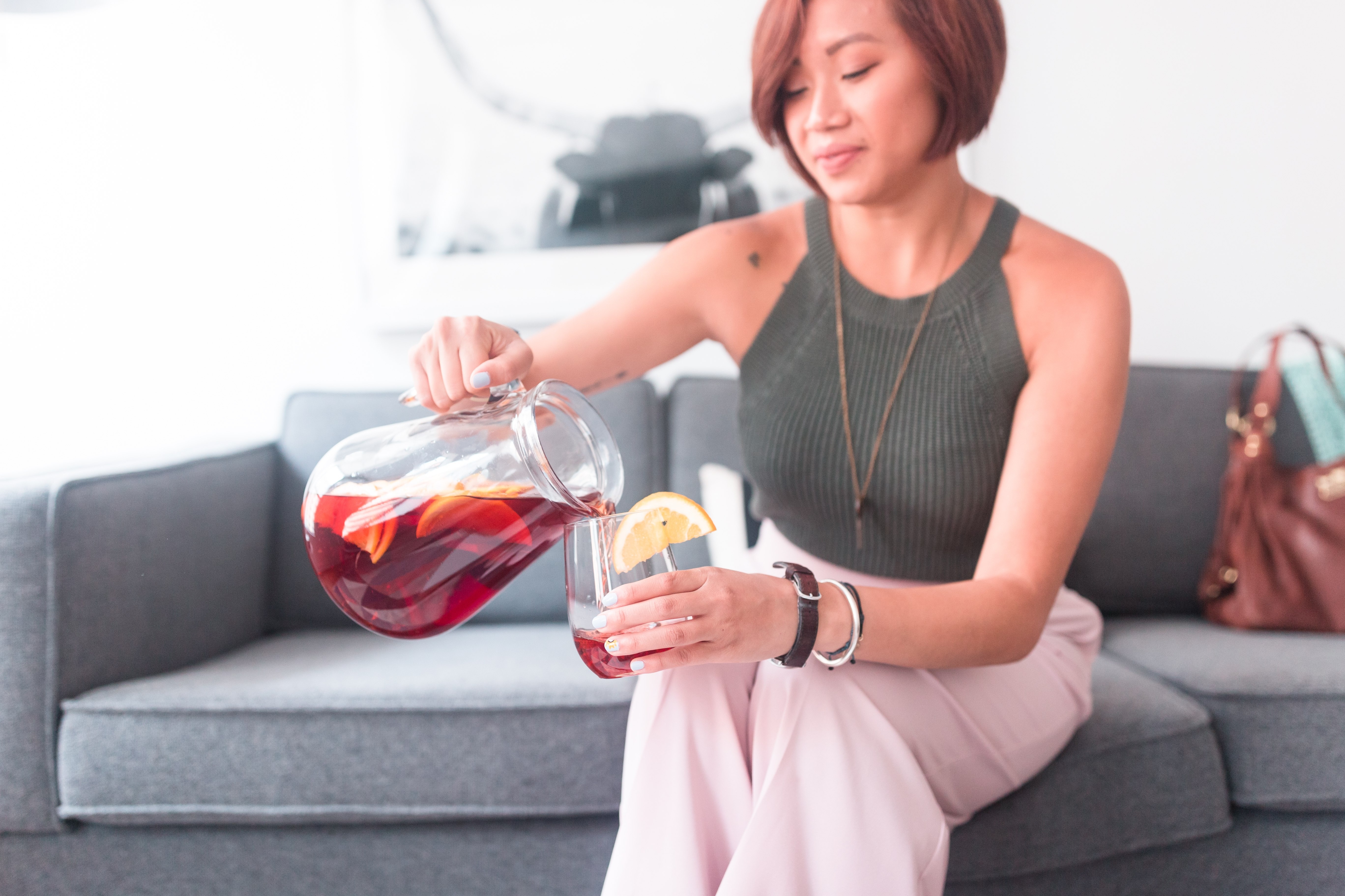 Cassandra of The Quirky Pineapple Studio pouring sangria