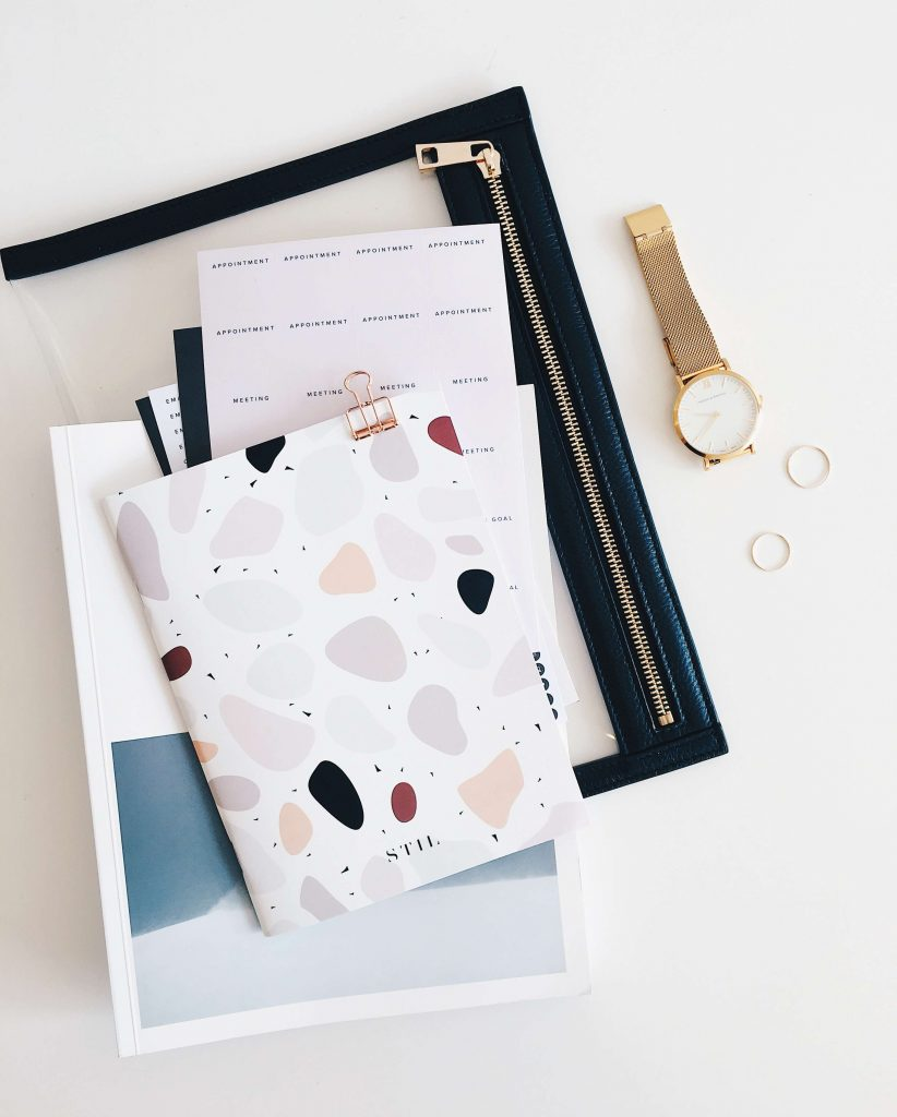 story toolkit notebook and files for marketing on desk with watch and rings