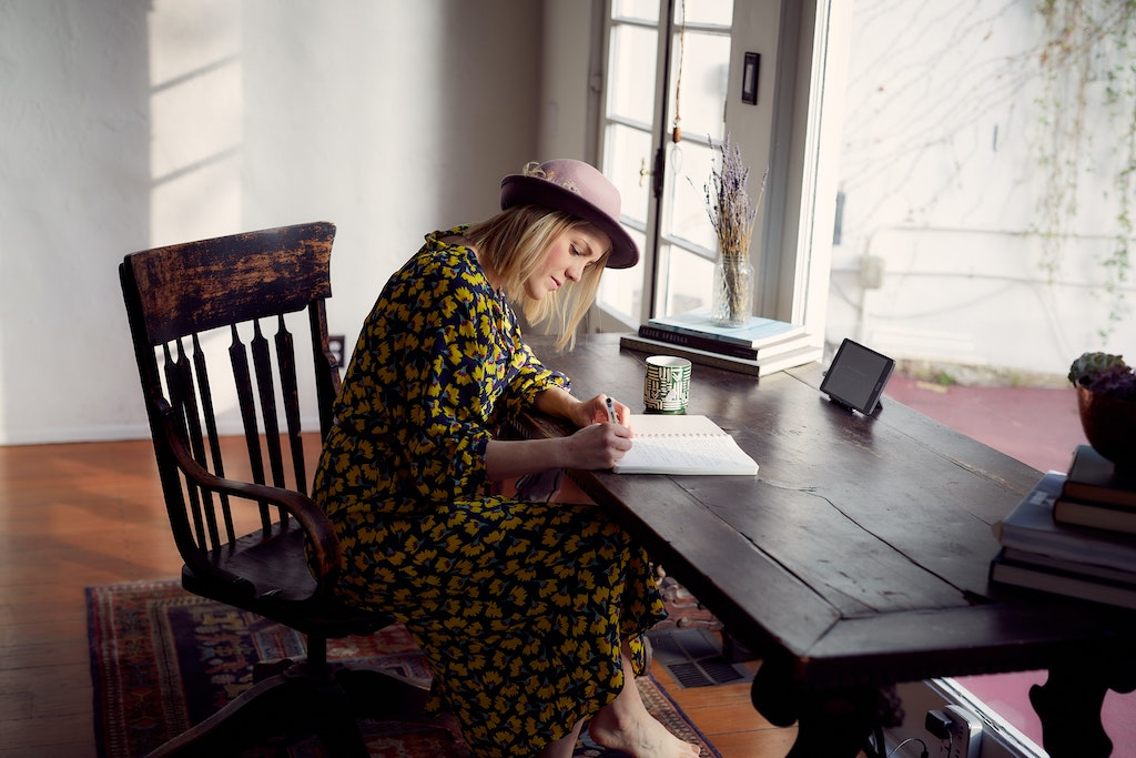 womxn sitting at a desk working on her brand voice