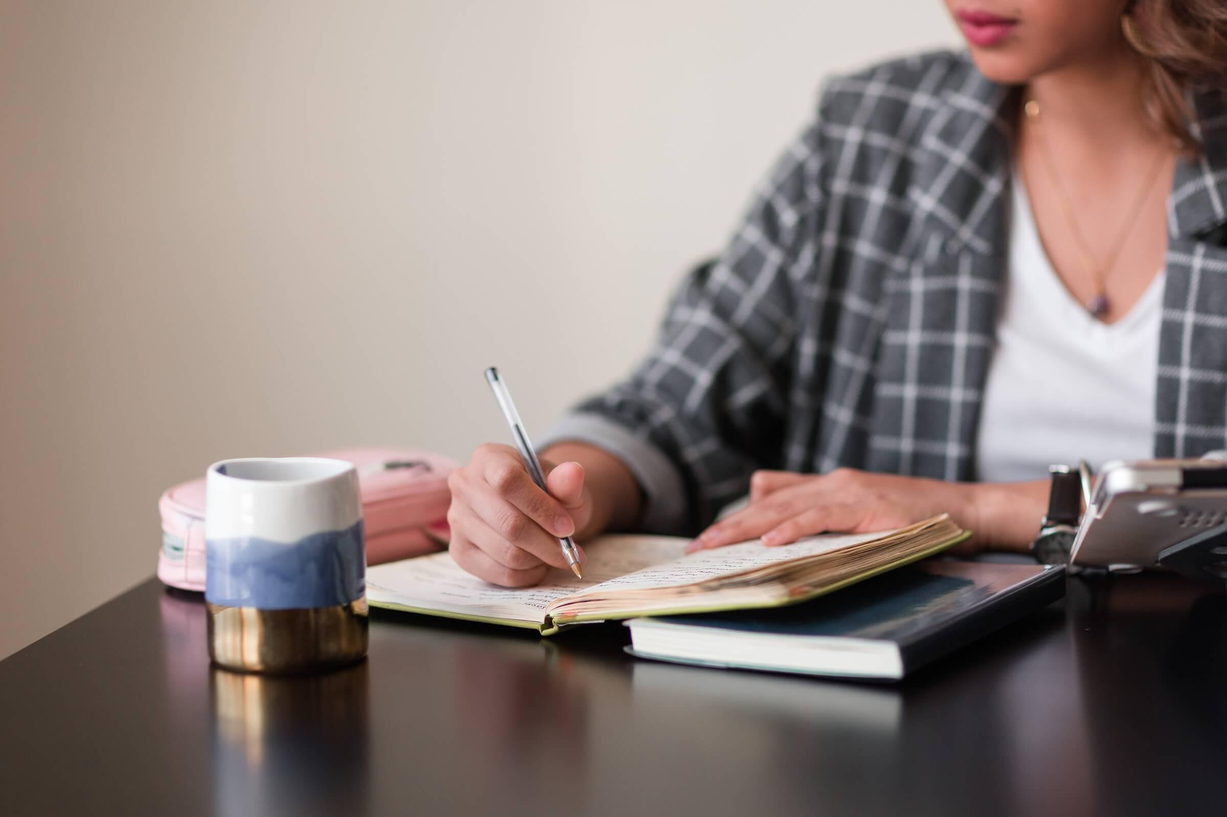 copywriter taking notes in their journal